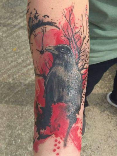 Trash Polka style raven and clock #tattooed #inked #trashpolka #trashpolkatattoo #blackandred #raven #clock #deadtree #dots #GeorgeAgnantis #NewFoundLandTattoo