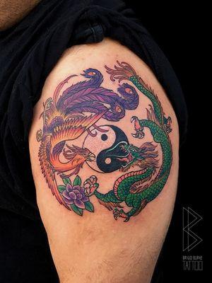 Dragon and pheonix tattoo. #dragontattoo #pheonixtattoo #color #colortattoo #lotustattoo