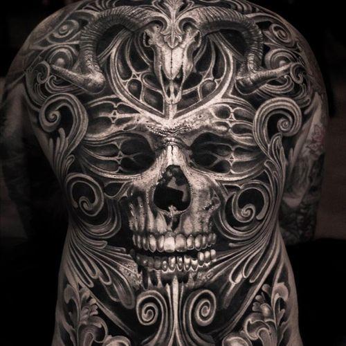 Tattoo by Mumia #Mumia #realismtattoos #hyperrealismtattoos #realism #hyperrealism #realistic #skull #stonework #cathedral #stainedglass #cattleskull #horns #filigree
