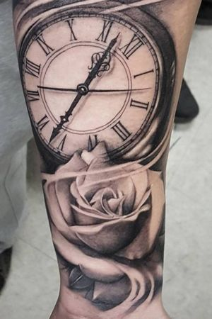 Clock and rose black and white.