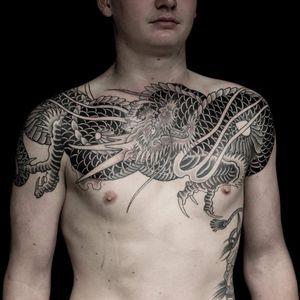 Tattoo by Tom Tom Tattoo #TomTomTattoo #favoritetattoos #favorite #blackandgrey #dragon #Japanese #irezumi #chesttattoo