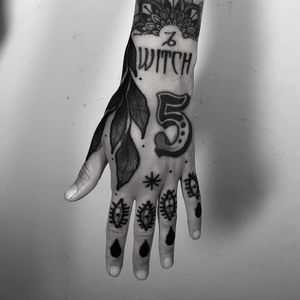 Tattoo by Laura Yahna #LauraYahna #blackwork #darkart #illustrative #number #5 #plant #eyes #star #dotwork #leaves