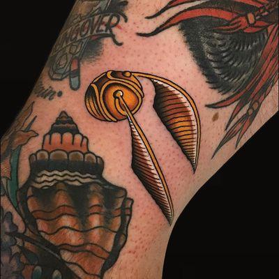 Tattoo by Alex Zampirri #AlexZampirri #FantasticBeasts #HarryPotter #JKRowling #HarryPottertattoos #goldensnitch #quidditch #game #color #traditional #gold #magic #Hogwarts