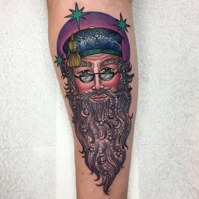 Tattoo by Roberto Euan #RobertoEuan #FantasticBeasts #HarryPotter #JKRowling #HarryPottertattoos #Dumbledore #stars #moons #wizard #Hogwarts #symbols #portrait #professor