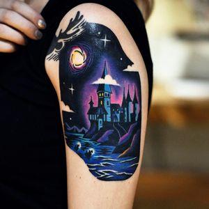 Tattoo by David Cote #DavidCote #DavidPeyote #FantasticBeasts #HarryPotter #JKRowling #HarryPottertattoos #Hogwarts #castle #moon #stars #lake #magic #newschool #color