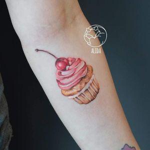 Tattoo by Alida Coloree #AlidaColoree #foodtattoos #foodtattoo #food #eat #realism #realistic #cupcake #cake #dessert #cherry