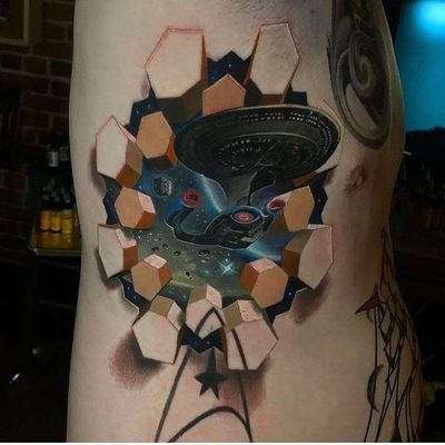 Tattoo by Jesse Rix #JesseRix #SciFitattoos #scifi #sciencefiction #color #realism #realistic #photorealism #hyperrealism #StarTrek #space #opticalillusion #spaceship