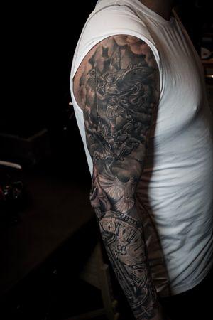 Black and g rey tattoo sleeve