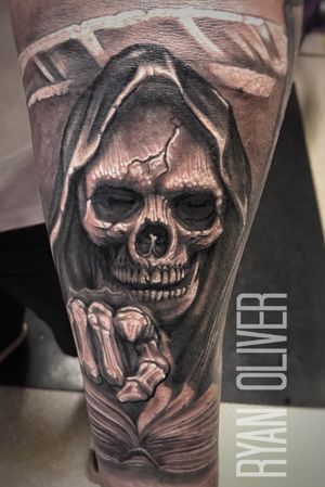 Black and grey grim reaper with scythe and book of the dead