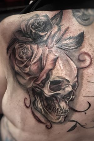 Cover up skull & roses tattoo