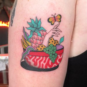 Tattoo by Albie aka albiemakestattoos #Albie #albiemakestattoo #80s #decorevival #surreal #illustrative #strange #funny #color #fruitbowl #fruit #pineapple #butterfly #grapes #food