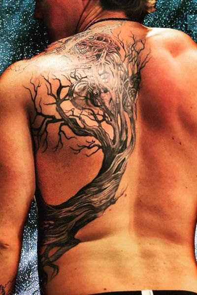 Zeus, hurling his thunderbolt, emerges from within a twisted, dead tree. Black and gray, white ink accents, and a light teal to make the lightning glow. Lower view. Done by Brian @Bonnevilletattoo............…..... #blackandgray #realism #twisted #dead #tree #zeus #god #lightning #thunderbolt #shield #back #backtattoo #shoulder #side #detailed #fineline #dark #black #tattoooftheday #nature #favorite