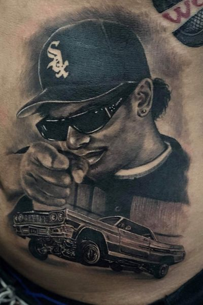 Last night's work. Portrait of 90's rapper Eazy E with vintage car. Planning to spend Christmas holiday in Phuket? Message us to reserve a spot for some ink to complete your bucket list! #angelink #angelinkphuket #patong #tom #thailand #portraittattoo #tattoodo #instinct #recommended #portraitaftist #eazye #nwa #tatuaz #thailand #thailande #tattoomodel #booknow #christmas #december #bucketlist #rapper #hiphop #tattoo #tattooshop