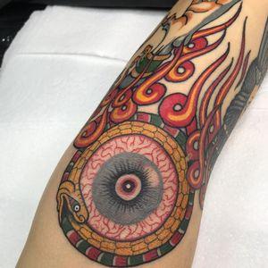 Tattoo by Alfredo Guarracino #AlfredoGuarracino #eyetattoos #eyetattoo #eye #psychedelic #surreal #strange #color #fire #Ouroboros #snake #reptile