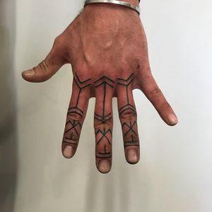 Tattoo by Luckman Tattoos #LuckmanTattoos #fingertattoos #fingertattoo #finger #hand #blackwork #linework #tribal