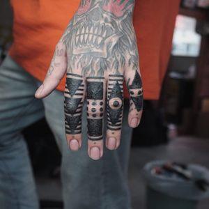 Tattoo by James Lau #JamesLau #fingertattoos #fingertattoo #finger #hand #blackwork #tribal #shapes #linework #dotwork