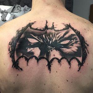 Classic Frank Miller Batman Logo with Gotham Demon's evil face...