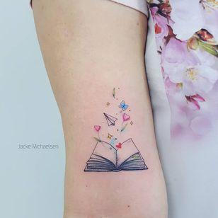 Tattoo by Jacke Michaelsen #JackeMichaelsen #booktattoos #booktattoo #book #literary #novel #reading #novel #small #flower #floral #tulip #heart #butterfly #illustrative #sparkle #paperplane