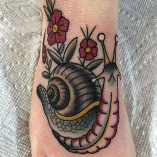 Tattoo by Chris Stuart #ChrisStuart #snailtattoos #snailtattoo #snail #animal #nature #color #traditional #flower