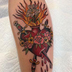 Tattoo by Chris Stuart #ChrisStuart #sacredhearttattoos #sacredhearttattoo #sacredheart #heart #fire #love #religious #color #traditional #rose #flower #iris #sword #blood