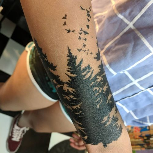 """A sign in our shop says... """"If you're going to get a Pinterest tattoo, let it be temporary."""" #trees #murderofcrows #pinterestinspiration #trends #airbrush #unrealtattoos"""