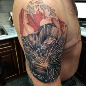 Welder and canadian flag map tattoo