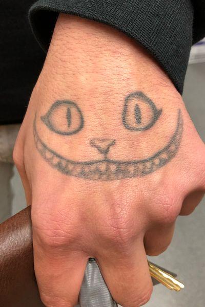 Cheshire cat hand tattoo #aliceinwonderland #wereallmadhere #cheshirecat