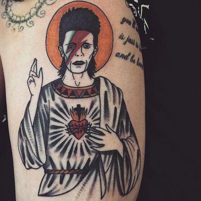 Tattoo by Cooley Tattooer #CooleyTattooer #tattoosoffamouspeople #famouspeopletattoos #famous #portrait #people #davidbowie #jesus #sacredheart #color #lightningbolt #ziggystardust #traditional