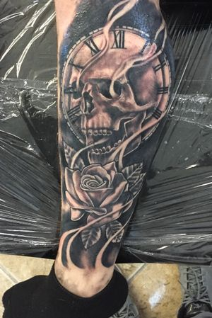 Skull with clock and rose