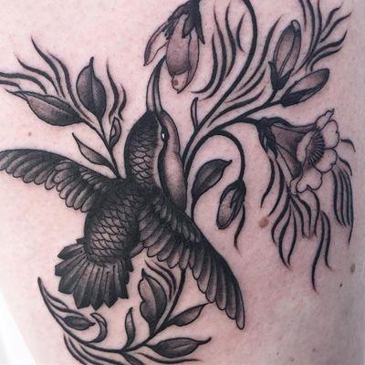 Tattoo by Lara Scotton #LaraScotton #tattoodoambassador #blackandgrey #nature #hummingbird #bird #feathers #wings #flowers #floral #leaves
