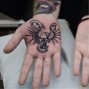 Tattoo by Jacob WIman #JacobWiman #tattoodoambassador #blackwork #linework #cat #feline #palmtattoo #minimal