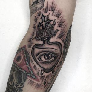Tattoo by Illegal Tattoos #IllegalTattoos #besttattoos #best #blackandgrey #sacredheart #fire #eye #cross #tears #chicano