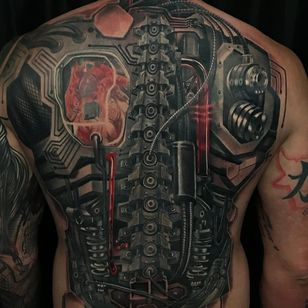 Tattoo by Austin Hueberger #AustinHueberger #robottattoos #cyborgtattoos #robot #cyborg #AI #mechanical #machine #biomechanical #backpiece #realistic #realism #hyperrealism
