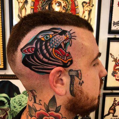 Tattoo by Samuele Briganti #SamueleBriganti #tattoodoambassador #color #traditional #panther #cat #junglecat #scalptattoo #headtattoo