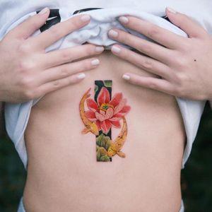 Two koi fish with lotus. Done in Canada, Toronto. #tattoo #Korea #tattooart #koreatattoo #koreatattooist #flowertattoo #illustration #birthflowertattoo #tattooistartmag #hongdae #flowers #coloredtattoo #watercolortattoo #hongdaetattoo #norigae #tattooistsion