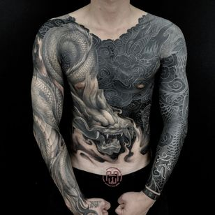 Tattoo by Heng Yue #HengYue #YinYangtattoos #YinYang #Chinese #symbol #blackandgrey #bodysuit #dragons #clouds #blackfill #chestpiece #sleeves #bodysuit #mythicalcreature #whiteink