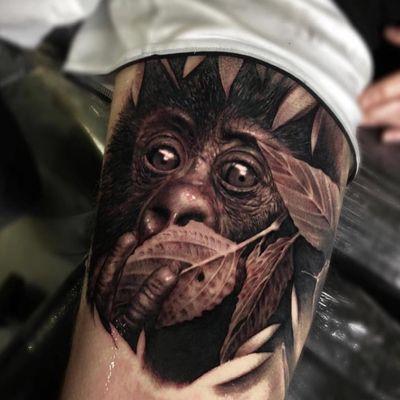 Tattoo by Ganga #Ganga #realisticanimaltattoos #realisticanimal #realistictattoo #animal #animaltattoos #nature #monkey #cute #leaf #plant #blackandgrey