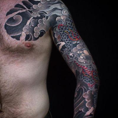 Tattoo by Sergey Buslaev #SergeyBuslaev #tattoodoambassador #Japanese #Japanesetattoo #Irezumi #dragon #waves #clouds #fire