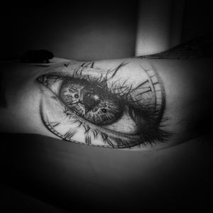 Black and grey fine line 3rl only realistic eye and time clock roman numeral tattoo on inner bicep