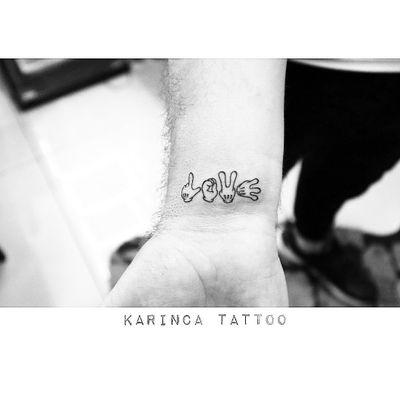 """Love"" with Mickey's hands 🐭👌🏻 Instagram: @karincatattoo #karincatattoo #black #mickey #love #minimal #little #tiny #tattoo #small #tattoos #tattoodesign #tattooartist #tattooer #tattoostudio #tattoolove #tattooart #tattooed #wrist #inkedup #cool #disney #istanbul #turkey #dövme #dövmeci #kadıköy #art"