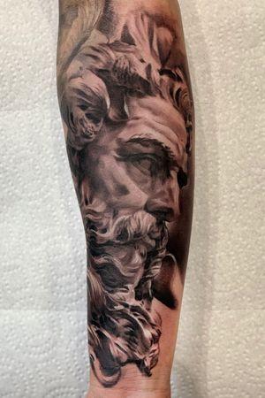 Poseidon statue tattoo