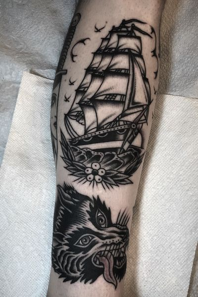 Tattoos by @zimovan #ship #shiptattoo #wolf #wolfhead #wolftattoo #blackandgrey #blackandgreytattoo #blacktattoo #blackwork #blackworktattoo #tattoos #ashevillenc #nctattooers #traditional #traditionaltattoo #AmericanTraditional