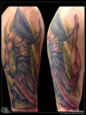 Tattoo by Chad Clark. #coveruptattoo #pyramidheadtattoo #pyramidhead #gore #floridatattooartist #capecoral #tophatclassictattoo #colortattoo #realism