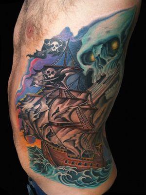 Tattoo by Chad Clark. #shiptattoo #piratetattoo #pirateshiptattoo #floridatattooartist #capecoral #jollyrogertattoo #tophatclassictattoo #colortattoo #traditional #traditionaltattoo #realism #coveruptattoo