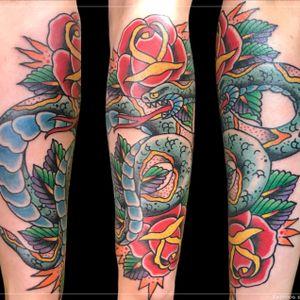 Tattoo by Chad Clark. #snaketattoo #rosetattoo #floridatattooartist #capecoral #tophatclassictattoo #colortattoo #traditional #traditionalsnaketattoo #traditionaltattoo