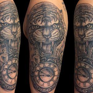 Tattoo by Chad Clark.  #tigertattoo #blackandgreytattoo #floridatattooartist #capecoral  #tophatclassictattoo #clocktattoo #realism