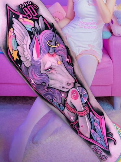Tattoo by Brando Chiesa #BrandoChiesa #tattoodoambassador #toptattoos #color #unicorn #horse #magic #90s #crystals #rainbow #halo #stars