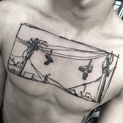 Tattoo by Stefano Phen #StefanoPhen #coolesttattoos #cooltattoo #favoritetattoo #besttattoo #illustrative #cityscape #landscape #shoes #electrical #telephonewires #architecture #chesttattoo #chest