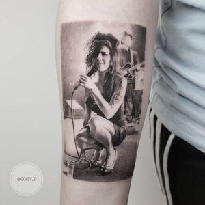 Tattoo by Goldy Z #GoldyZ #musiciantattoos #musician #portrait #music #blackandgrey #amywinehouse #singer #rip #realism #realistic