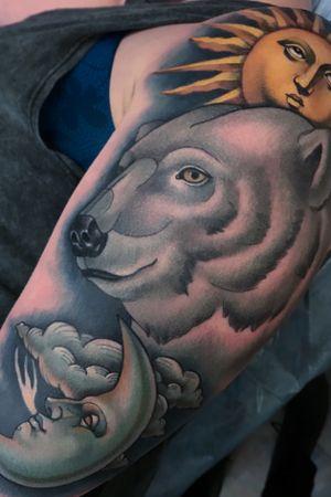 Polar bear with sun and moon tattoo